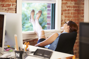 Businesswoman On Phone Relaxing In Modern Creative Office